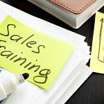 Sales Training post it on a desk