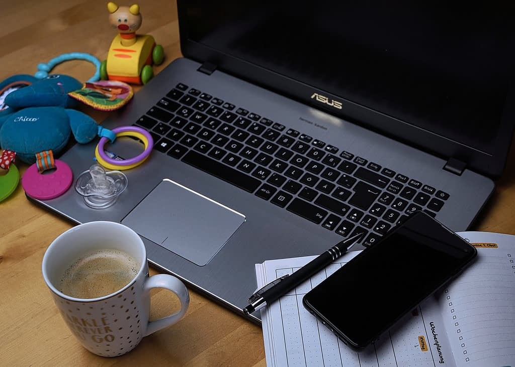 work life balance - image of a computer surrounded by home objects and toys