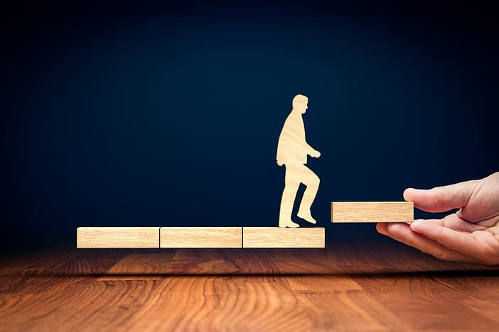 leadership coaching topics: outline image of business person stepping up