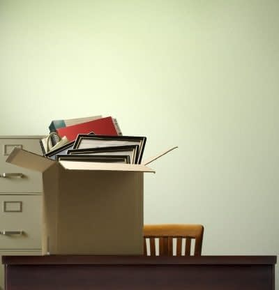 Career coaching - image of belongings packed in a box on a desk
